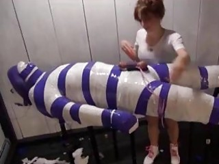 Enduring mummification only his cock is left for teasing BDSM