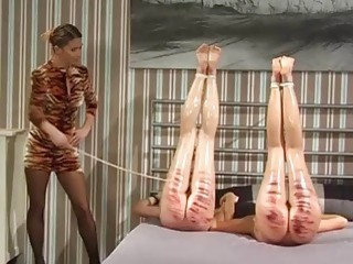 Lesbian slave babes whipped until butts are red BDSM porn