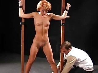 Lezdom mistress whips her slaves with a cane BDSM porn