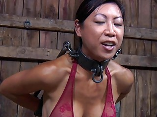 Horny Asian gets whipped in a very delicate bondage scene