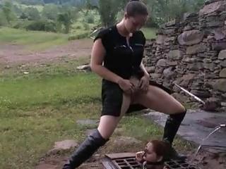 Caged slave slut gets pissed on by mistress outdoors BDSM