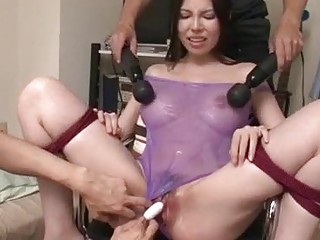Tied submissive bitch cums as her men toy her pussy