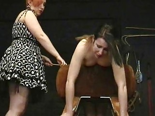 Busty brunette submissive girl get punished by chubby older dominatrix