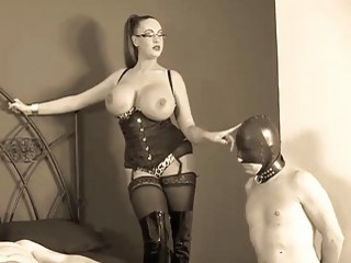 Babe with big titties forces male slave to suck dick