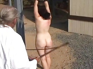 Chick is restrained and then whipped in the outdoors hard