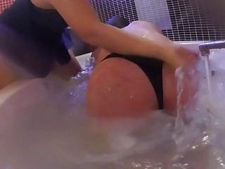 This big ass gets spanked hard in the bath tub