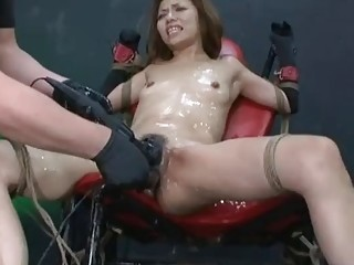 Kinky Asian babe is having a strong orgasm using toys