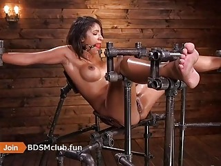 Submissive naked slave girl enjoys hardcore BDSM and extreme bondage