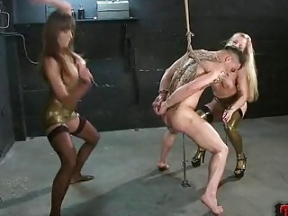 Two gorgeous babes enjoy BDSM and femdom with their slave