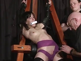 Submissive topless MILF obeys bondage and BDSM with her master