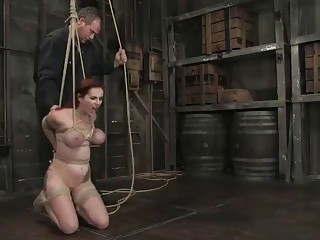 Submissive naked girl with big tits enjoys BDSM and bondage