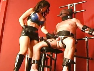 Mature dominatrix loves to cock torture her bound slave BDSM