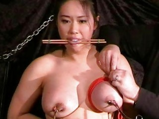 Master plays with Asian slave's nipples while she toys herself