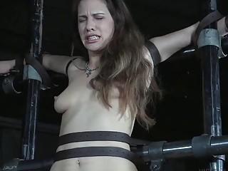 Tied up Devilynne endures hard pain with toys BDSM porn