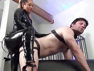 Asian mistress in leather fucks her slave with strapon BDSM