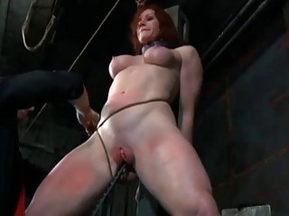 Redhead chick Catherine DeSade gets tied up and molested BDSM