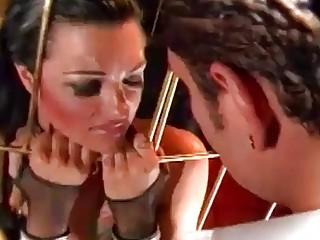 Caged skank Belladonna gets mouth fucked by Nacho Vidal BDSM