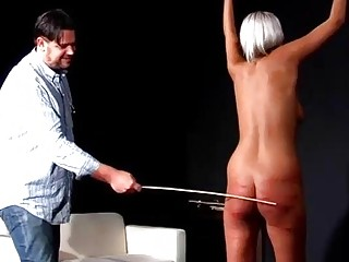 Naked slave girl receives hard whipping and caning BDSM porn