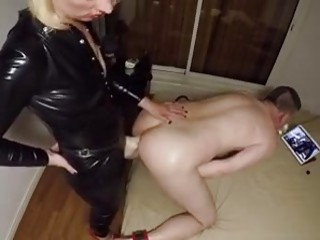 Femdom bitch in leather fucks her slave with strapon BDSM
