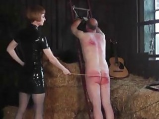 Male whipping BDSM time with bound slave and two mistresses