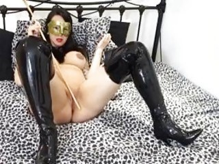 Strict lady with big tits plays with a whip BDSM