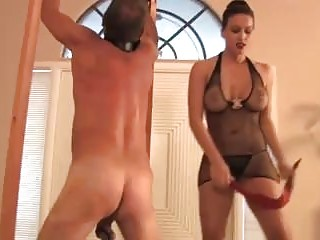 Sadistic mistress whipping a spread tied submissive slave BDSM porn