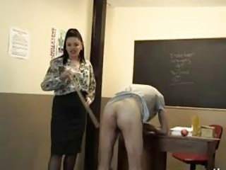 Teacher gets feet worshiped and whips her obedient BDSM slave