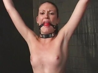 She's standing spread eagle and getting her pussy tortured hard
