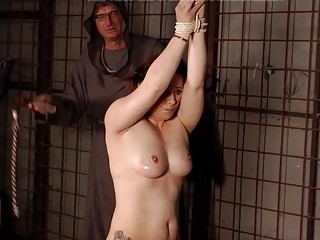 Babe is tied up and her back is whipped harshly