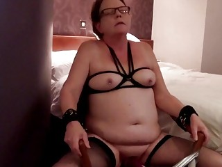 Old woman gets her big tits tied up for master