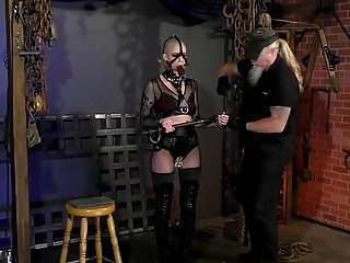 Man with ponytail ties up bald babe in his dungeon