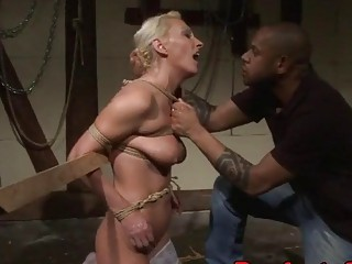 Mature woman gets tied up in dungeon and fucked hard