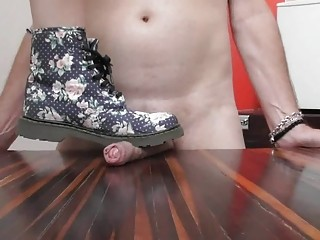 He gets his cock stepped on by a harsh domme