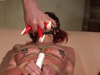 Redhead is teased with candle wax and fucked very hard