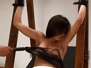 Skinny bitch is tied up and whipped by a sadist