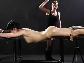 Enticing gal with small titties gets her ass caned hard