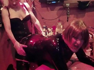 Submissive dude bends over and gets used by horny mistresses