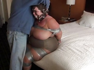 Big titty mature woman is tied up on the bed