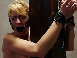 White girl is tied up and whipped by her dom
