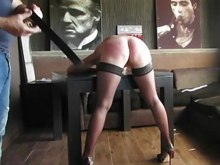 Babe bends over and gets her ass slapped by master