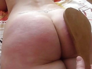 Chick with fat ass gets spanked hard with a paddle