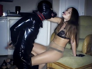 Dude in latex suit licks his mistresss's feet real hard