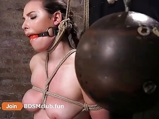 Bondage with ropes and gags for a submissive brunette chick