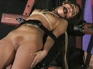 Submissive naked girl enjoys BDSM and bondage with her master