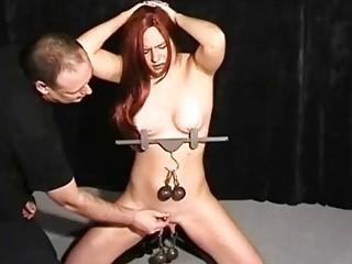 Gorgeous horny naked girl enjoys rough BDSM and extreme bondage