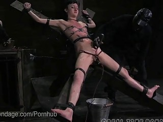Submissive naughty naked girl enjoys rough BDSM and hardcore bondage
